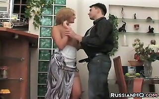 older russian drilled by a youthful lad