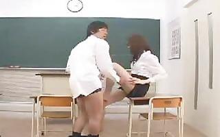 oriental teacher copulates her student