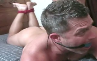 a beefcake cums all over his tied buddys butt