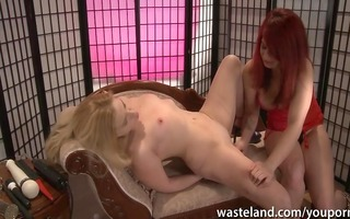 domme inserting different dildos into her sex