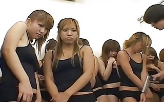 oriental gals are in gym class drilled by soldiers