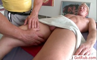 golden-haired getting his nuts oiled for massage