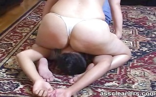 dominatrix in bikini smothers villein by sitting