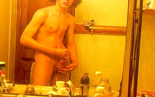 curly-haired twink in washroom