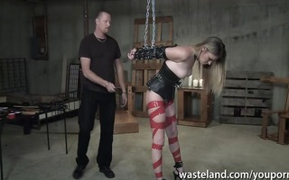 blond is handcuffed and spanked by slavemaster