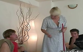 old cleaning woman takes knobs