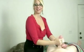 excited blond masseuse in glasses tugs rod