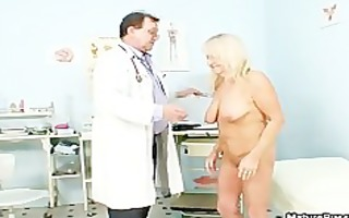 impure old doctor inspecting