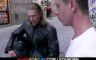 muscle biker is enticed by a gay