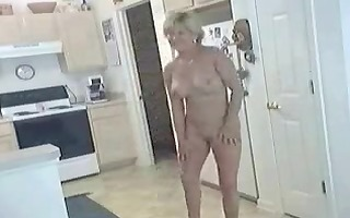 older hot mamma in natures garb in kitchen