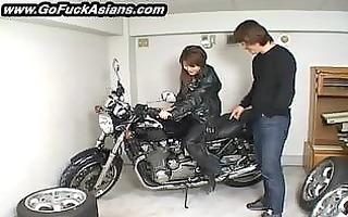 oriental bikerchick receives her muff tickled