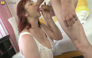 older redhead mama shows off massive scoops and