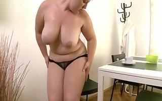 overweight girl masturbates with black fake