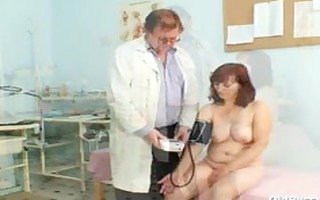 zita aged woman gyno speculum exam at clinic
