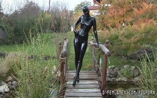 insane gal in constricted rubber disrobes outdoor