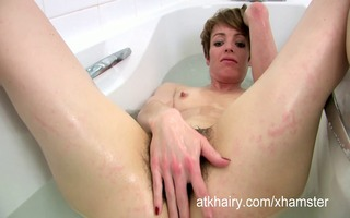 maria washes her bushy bush in the soapy water