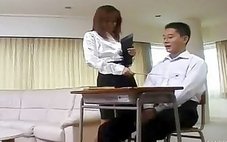 oriental teacher has her student -