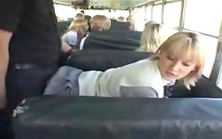 blond school cutie and oriental lad in the bus