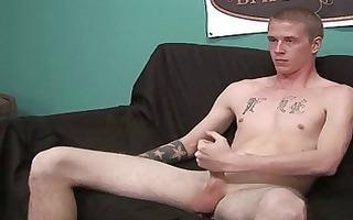 naked hot tattooed stud masturbates