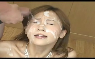 japanese babe covered in cum