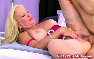 sexy golden-haired grandmother on her back