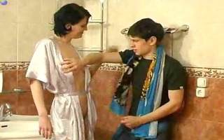 aged woman teasing youthful lad