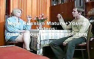 russian mamma and lad having a swallow