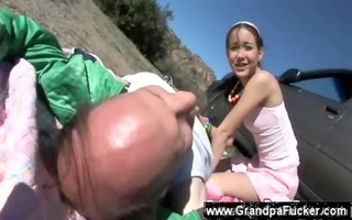 oriental legal age teenager sits on seniors face
