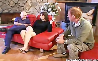 wife drilled on a red couch