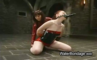 fastened lesbos gagged together receives sprayed