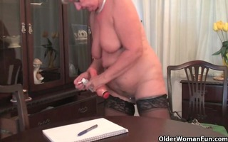 chubby granny in stockings plays with fake ramrod