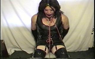 little miss christi chair bondage wearing rubber