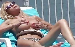 big tits milf spied on whilst sunbathing