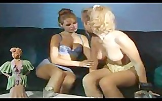 two excited lesbian babes fucking on daybed