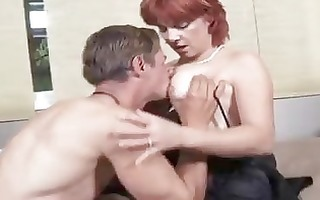 frisky aged redhead in fishnets