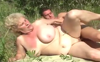 german granny outdoor with young stud by troc