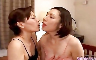 2 sweethearts giving a kiss rubbing titties one