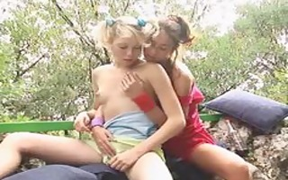 blond lesbian friens outside on a chair