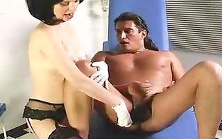 femdom nurse toying a guy