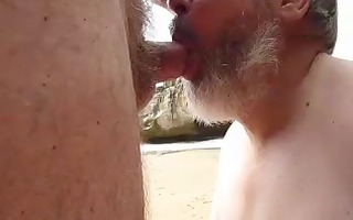 dave gives nat a valuable headjob at the beach